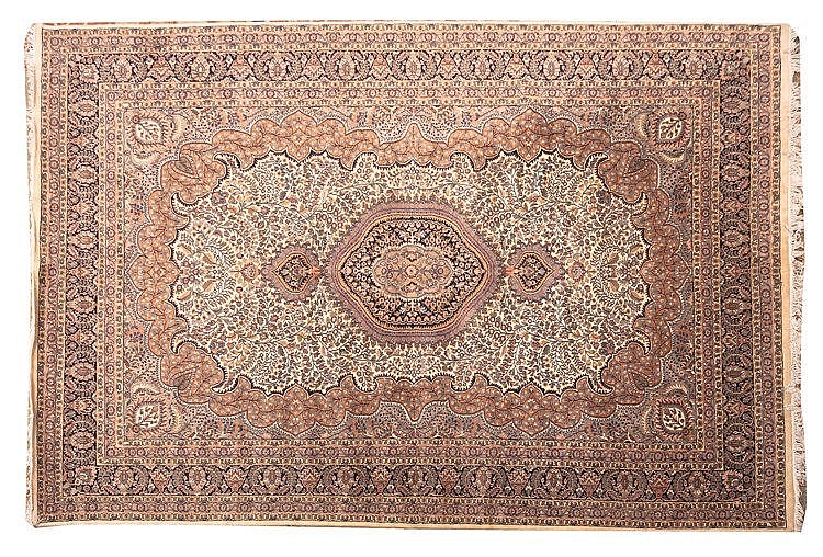 AN ORIENTAL WOOL CARPET