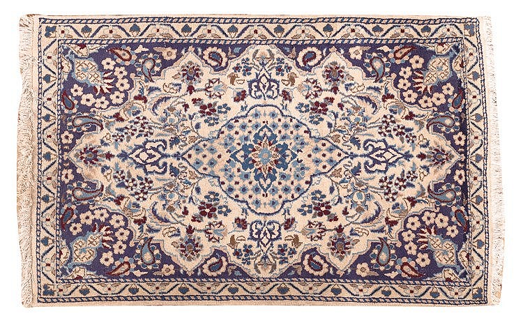 A PERSIAN WOOL CARPET