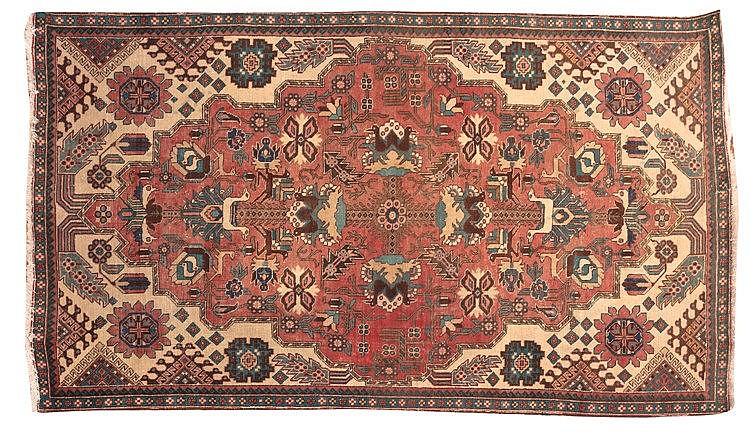 A WOOL CARPET, 20TH CENTURY