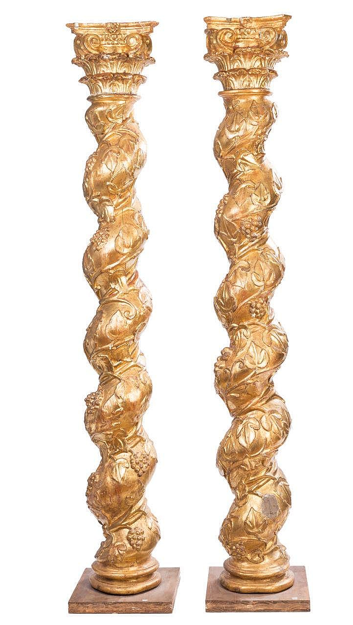 A PAIR OF CARVED AND GILTWOOD COLUMNS, 17TH CENTURY