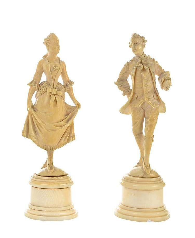 A PAIR OF IVORY FIGURES, 19TH CENTURY