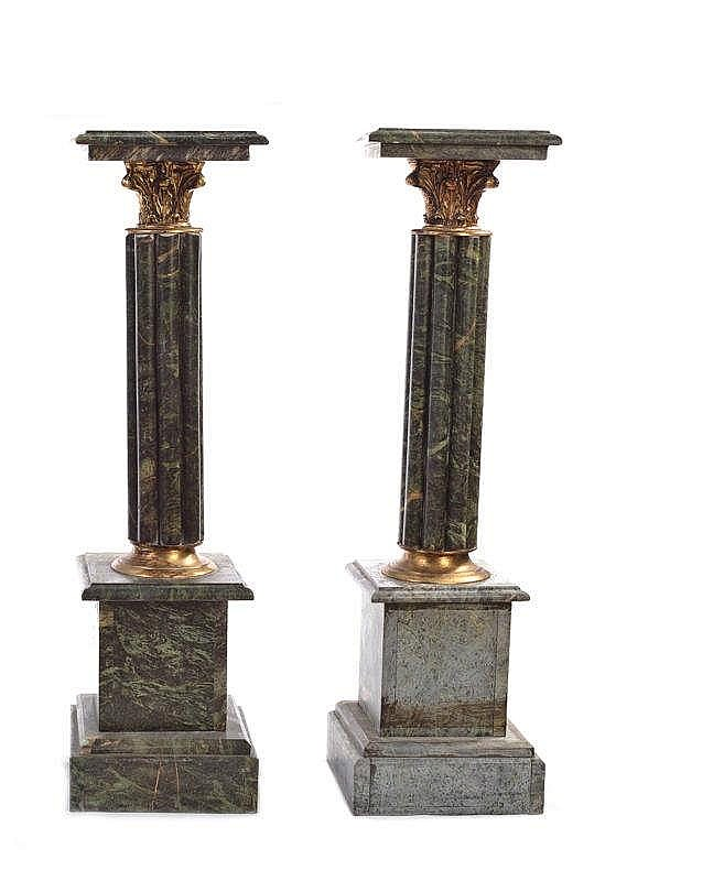 A PAIR OF GREEN MARBLE PEDESTALS
