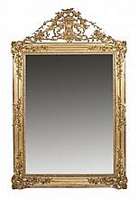 A CARVED GILTWOOD WALL MIRROR