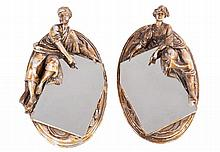 A PAIR OF FIGURAL MIRRORS