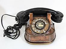 copper and Bakelite rotary dial telephone