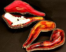 Lot of 2 sculpted pipes