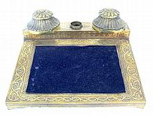 A brass double inkwell