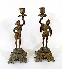 A pair of bronze candlesticks