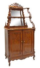 End of 19th century Europe A small walnut sideboard with mirror and shelves