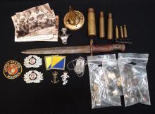 Bag with Australian insignia, german helmet spike, 1888 pattern bayonet, shells, buttons,
