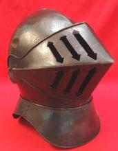 19th century reproduction of a stylised tinplate 16th century style Knight's helmet