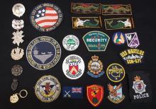 Lot of 6 Australian & Irish cap badges, including Irish Helmet badge & patches