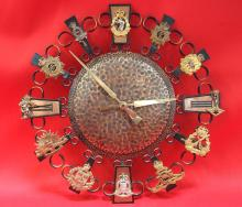Clock, brass, with attached Australian Army regiment & corps cap badges.