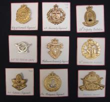Lot of 9 Australian cap badges, all have Queen's Crown and lugs