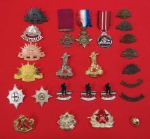Mixed bag of original and copy medals and badges