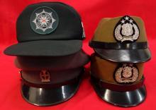 Lot of Asiatic Police caps.