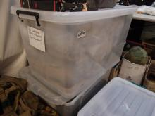 Very large plastic tub with U.S. tactical gear