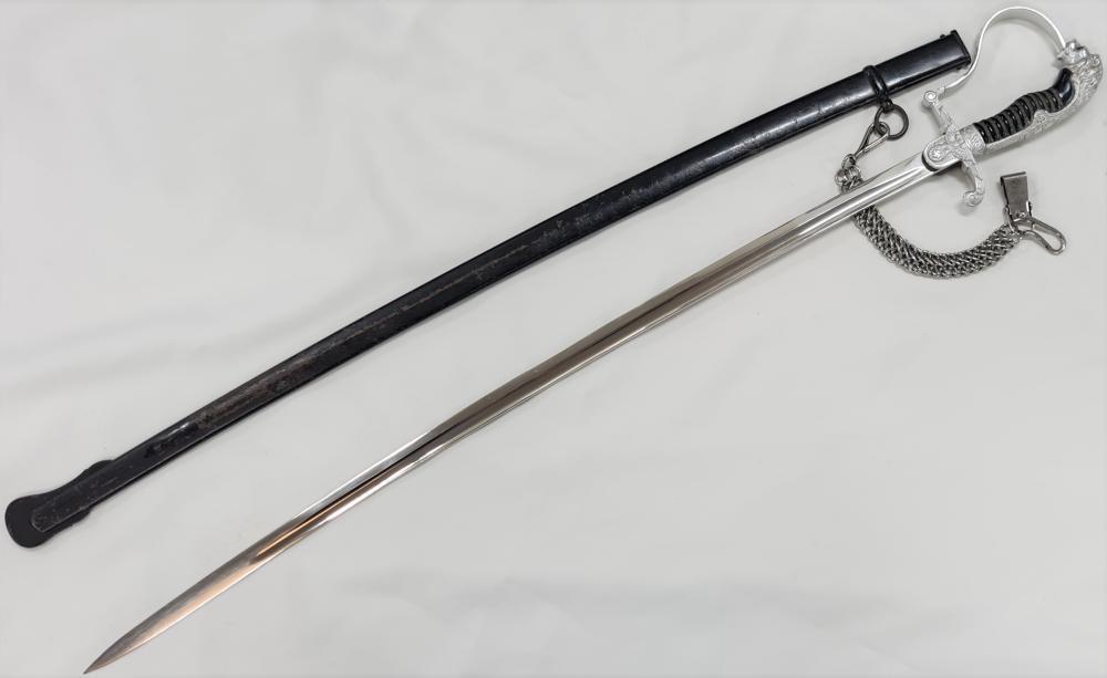 WW2 Germany S.S. officer's lions head sword & chained hanger to Sturmbannführer Heinz Macher