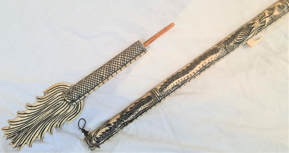 20th century Indonesian dragon head bone blow dart pipe