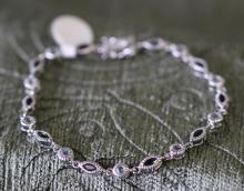 Antique look sapphire / blue topaz tennis bracelet