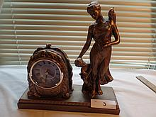 Metal figurine clock
