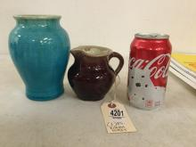 """(2) PISGAH FOREST ART POTTERY PCS. 6"""" HIGH BLUE VASE MARKED ON BOTTOM 1942 & BROWN PITCHER WITH STEPHEN MARK, MEASURES 4"""" HIGH."""
