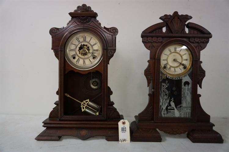 (2) VICTORIAN WALNUT MANTEL CLOCKS, WITH PENDULUMS, RUNNING, NO KEYS, ONE HAS ORIGINAL GLASS DOOR, ONE HAS NO GLASS IN DOOR, ONE IS A GILBERT, OTHER IS WATERBURY. FROM THE MARS COLLECTION, AS PICTURED