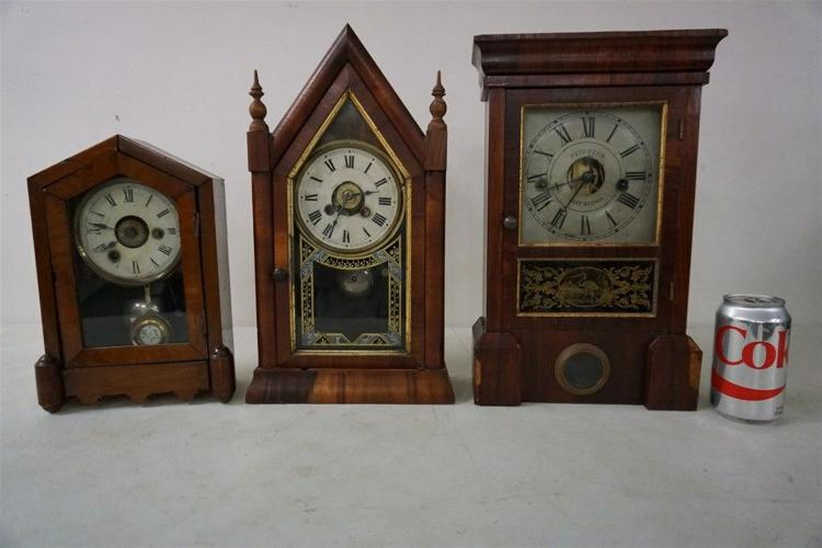(3) EARLY MANTEL CLOCKS INCLUDING JEROME & CO. GOTHIC STYLE, SMALLEST MAHOGANY GOTHIC STYLE, AND ROSEWOOD CASE SETH THOMAS, SOME VENEER DAMAGE ON BASE, ALL HAVE PENDULUMS, AND SETH THOMAS HAS KEY. APPEAR TO BE RUNNING, FROM THE MARS COLLECTION, AS