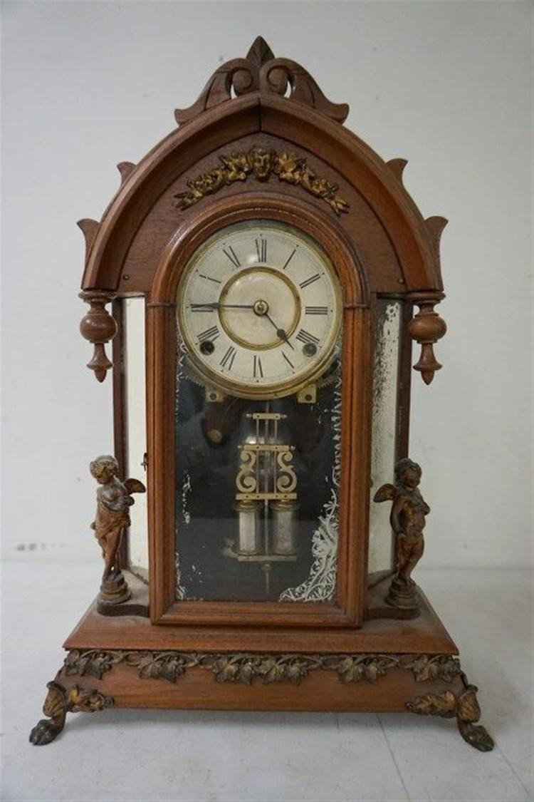 ANSONIA VICTORIAN MANTEL CLOCK WITH FIGURAL CHERUBS AND MIRRORED SIDES, HAS PENDULUM, RUNNING, WALNUT, FROM THE MARS COLLECTION. HAS ORIGINAL PAPER LABEL ON BACK, AS PICTURED.
