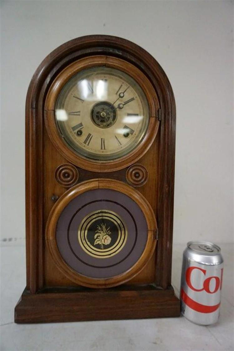 ROSEWOOD MANTEL CLOCK, RUNNING, HAS PENDULUM, NO KEY, REVERSE PAINTED DOOR, CRACK IN GLASS DOOR ON TOP, MEASURES 18 1/4
