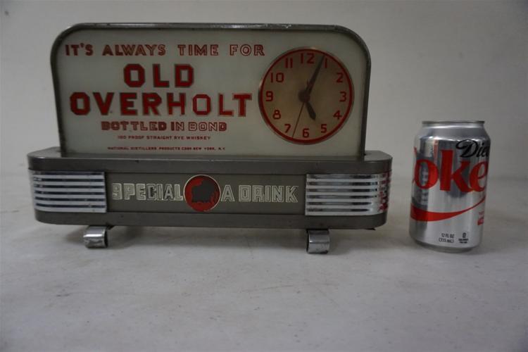 OLD OVERHOLT DECO ADVERTISING DISPLAY CLOCK, NOT RUNNING, MEASURES 14 1/2