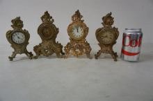 4 DECORATIVE NOVELTY CLOCKS, FROM THE MARS COLLECTION, AS PICTURED