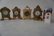 4 GILT WHITE METAL SMALL CLOCKS, 2 W/PORCELAIN DIALS, AS IS, FROM THE MARS COLLECTION, AS PICTURED