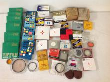 BOX OF CAMERA FILTERS IN ORIGINAL BOXES. ALL SORTS, MANY SIZES, INCLUDING TIFFEN, NIKKOR, PEERLESS, KODAK, HOYA, SPIRALITE AND OTHERS, AS PICTURED