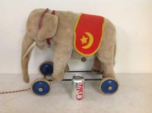 LARGE STEIFF ELEPHANT ON WHEELS, BUTTON IN EAR, MEASURES 22
