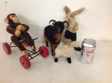 4 VINTAGE PLUSH ANIMALS INCLUDING STEIFF BUNNY RABBIT-MATERIAL ON SHOE COMING APART, MONKEY W/GLASS EYES ON TRIKE, BIG HORN SHEEP & MOUNTAIN GOAT, AS PICTURED