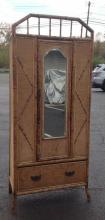 BAMBOO 1 DOOR CIRCA 1900 ARMOIRE WITH 1 DRAWER, SOME WEAR TO THE WEAVING ON DRAWER, HAS 2 SHELVES INSIDE, MEASURES 77