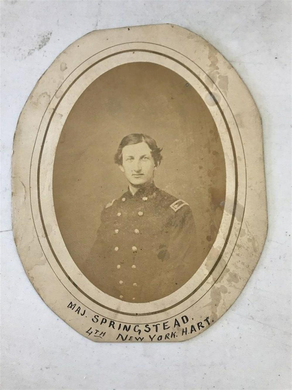 "CIVIL WAR OVAL PORTRAIT OF MAJOR EDWARD A. SPRINGSTEAD, 7TH NY HEAVY ARTILLERY. HE WAS WOUNDED IN ACTION ON JUNE 16, 1864 AT PETERSBURG, VA. AND KILLED IN ACTION ON AUG. 25, 184 AT REAM'S STATION, VA. PHOTO IS 7 1/4"" X 5 1/4"" ON 9 1/2"" X 7 3/4"""