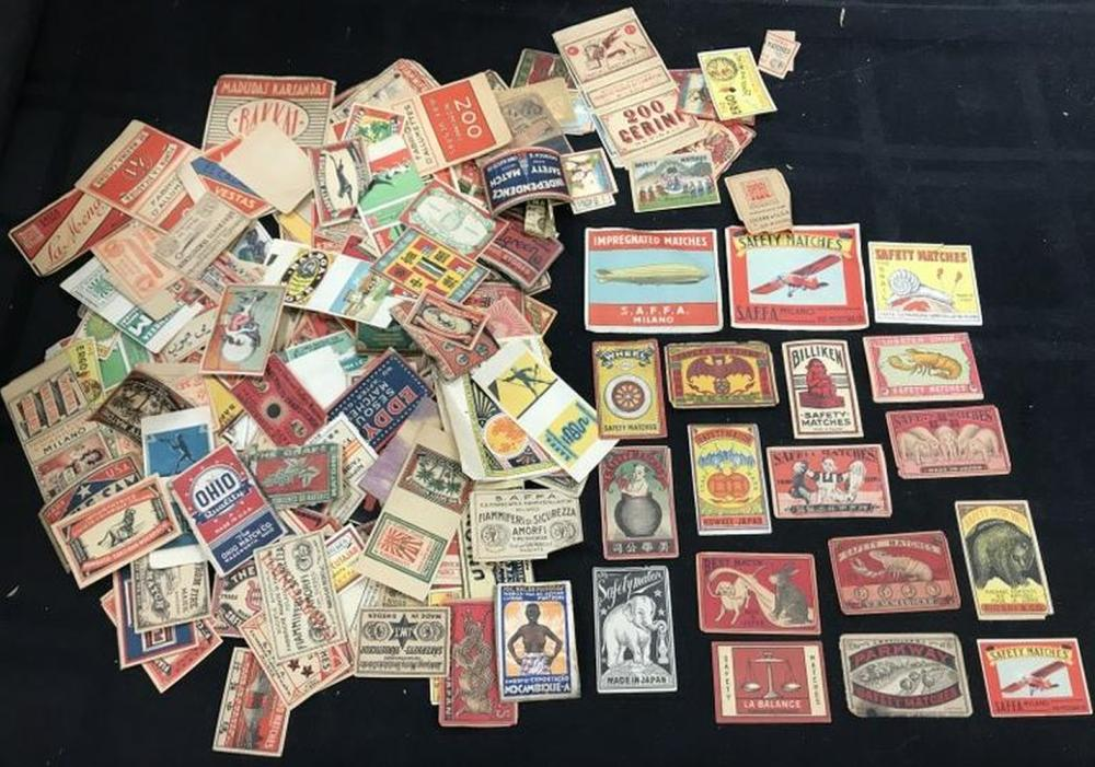 100'S OF EARLY FOREIGN MATCHBOOK PAPER LABELS, GREAT GRAPHICS, ZEPPELINS, AIRPLANES, ANIMALS, TIRES, TRANSPORTATION, PEOPLE, VERY COLORFUL, FROM LOCAL ARTIST'S ESTATE, WHO TRAVELED WORLDWIDE. GRET LOT FOR ANY COLLECTOR OR DEALER.