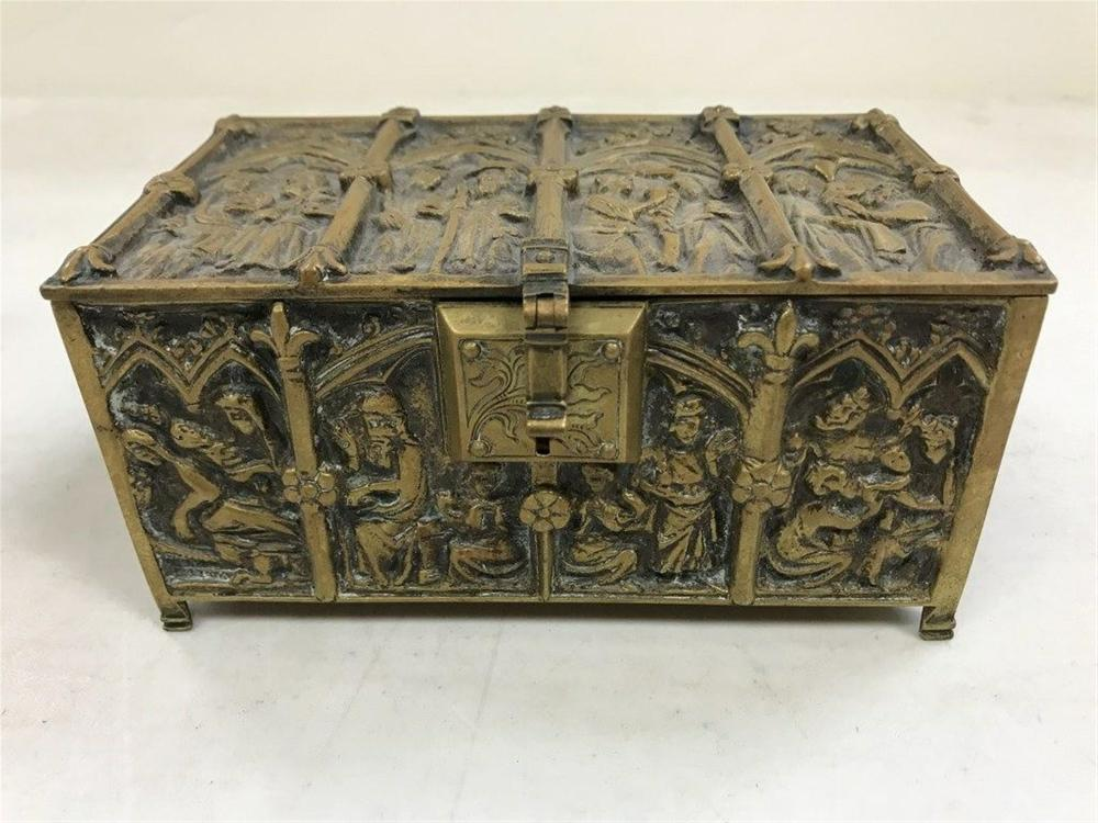 "19TH C GERMAN HEAVY BRASS RELIQUARY BOX, MARKED E. SCHUEMARKE, WITH PANELED FIGURAL DESIGNS ON ALL SIDES AND TOP, MEASURES 6"" X 3 1/2"" X 3"" HIGH.  SUPERIOR QUALITY, HAS BEEN STORED IN A NEW YORK STATE MONESTARY SAFE FOR OVER 70 YEARS."