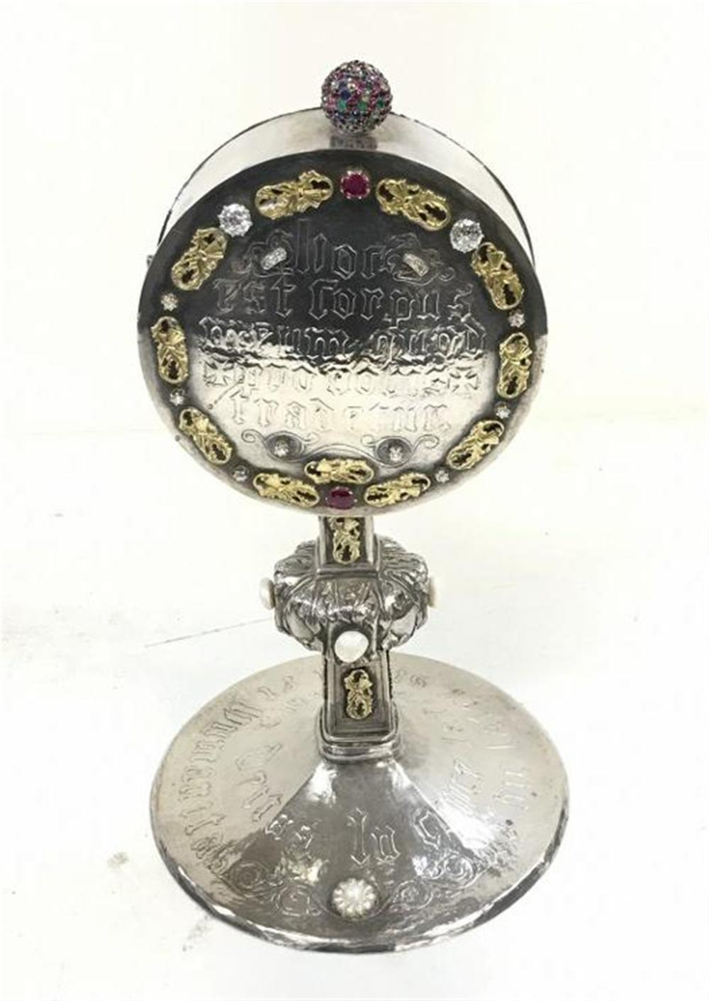 "IMPORTANT SILVER THECA, CIRCA 1920'S, THE ROUND HINGED CASE WITH A ""DOOR"", IS DELICATELY CHASED SET WITH 4 AMETHYSTS. THE REVERSE SIDE IS INSCRIBED AND SET AROUND WITH BELIEVE GOLD LEAVES AND (2) DIAMONDS; ONE 1.25 CARATS WITH A GRADE V.S.I. AND A"