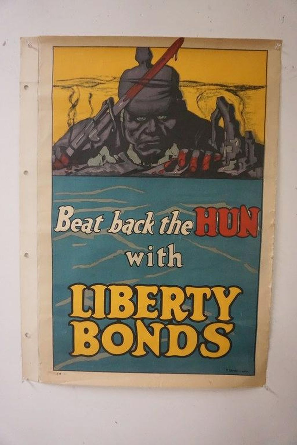 BEAT THE HUN WITH LIBERTY BONDS WW I POSTER, LINEN BACKED, APPEARS TO HAVE BEEN IN ALBUM OF POSTERS AT ONE TIME, NICE OVERALL CONDITION, WAS FOUND ROLLED. F. STROTHMANN IS IN BOTTOM RIGHT CORNER.  SOME SMALL BORDER CRINKLES?.