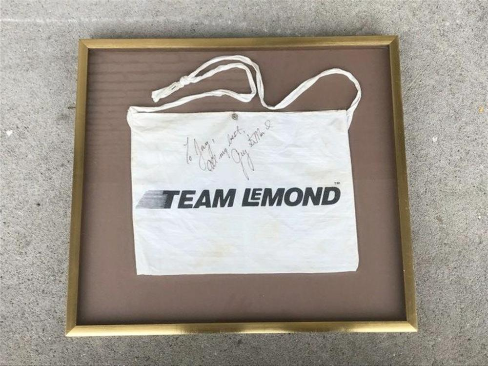 "GREG LEMOND SIGNED TEAM LEMOND RACING BAG, NICELY FAMED, GENTLEMAN IS A RACING FAN AND GOT IT DIRECTLY SIGNED TO HIM, AFTER A RACE. FRAME MEASURES 19"" X 21""."