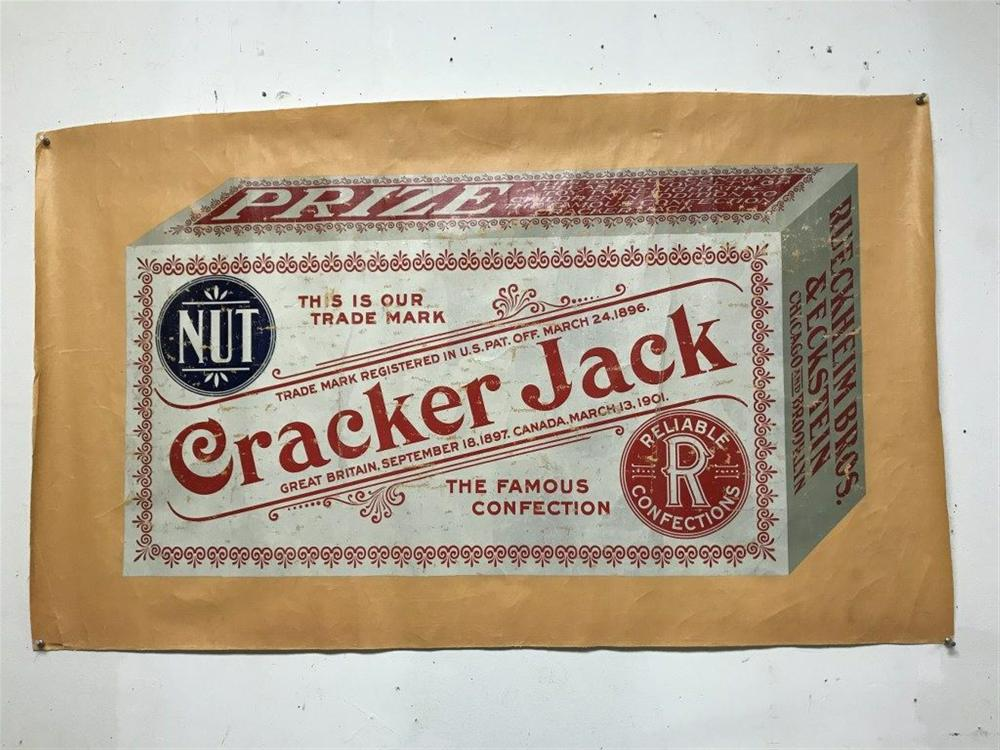 "CRACKER JACK ADVERTISING POSTER ON OIL CLOTH/LINEN, SOME CRACKLING, MEASURES 25"" X 42"". CIRCA 1920'S OR ABOUTS IS MY GUESS??"