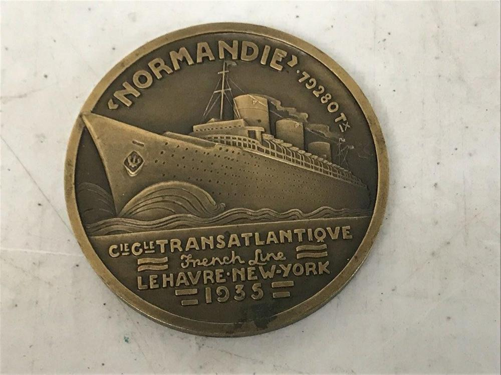 "BRONZE NORMANDIE 1935 SOUVENIR MEDAL , SHIP ON ONE SIDE, WOMAN AND HORSE ON OTHER SIDE, CIE CLE TRANSATLANTIQUE FRENCH LINE, LE HAVRE NEW YORK, MEASURES 2 5/8"" ACROSS, AS PICTURED"