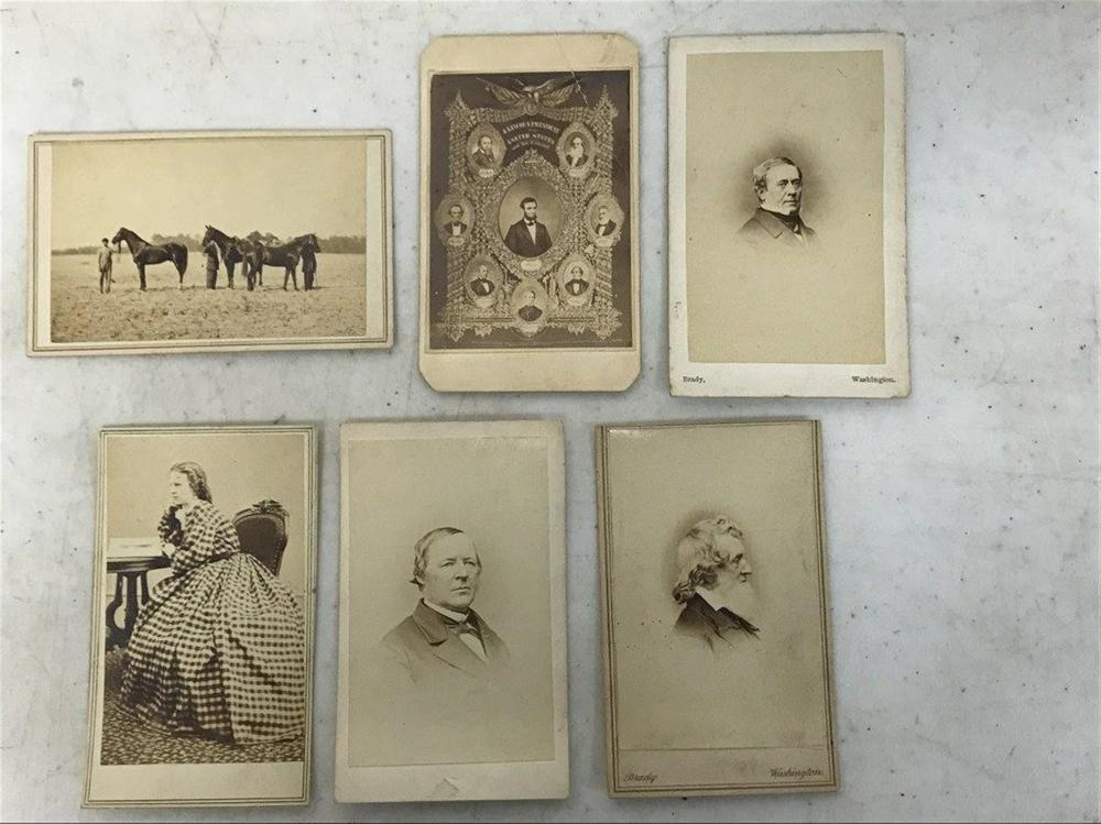 M BRADY & OTHER CDV'S FOUND IN ESTATE BOX OF MAGIC LANTERN SLIDES,  IN AS FOUND ESTATE CONDITION, INCLUDES (3) MATHEW BRADY CDV'S OF GENTLEMEN, UNIDENTIFIED, A LINCOLN CDV, ALEX GARDNER CDV OF WOMAN, & UNMARED CDV OF PEOPLE WITH HORSES, INCLUDING A BLACK MAN ON THE LEFT.