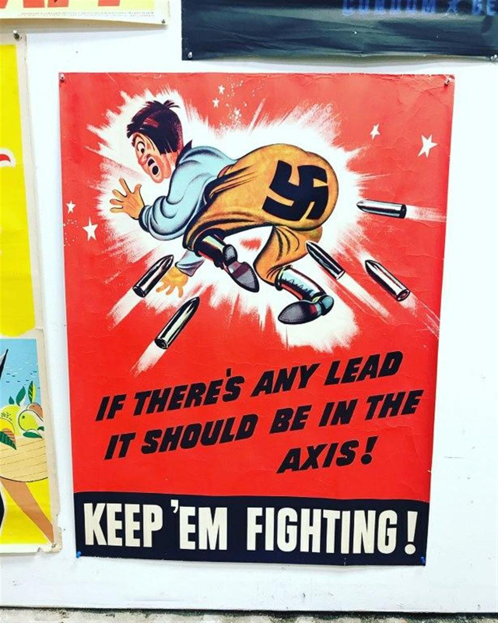"POSTER- GERMAN PROPAGANDA POSTER IF THERE'S ANY LEAD IT SHOULD BE IN THE AXIS  KEEP EM FIGHTING. SOME SMALL BORDER RIPS, POSTER MEASURES 40"" X 30""."