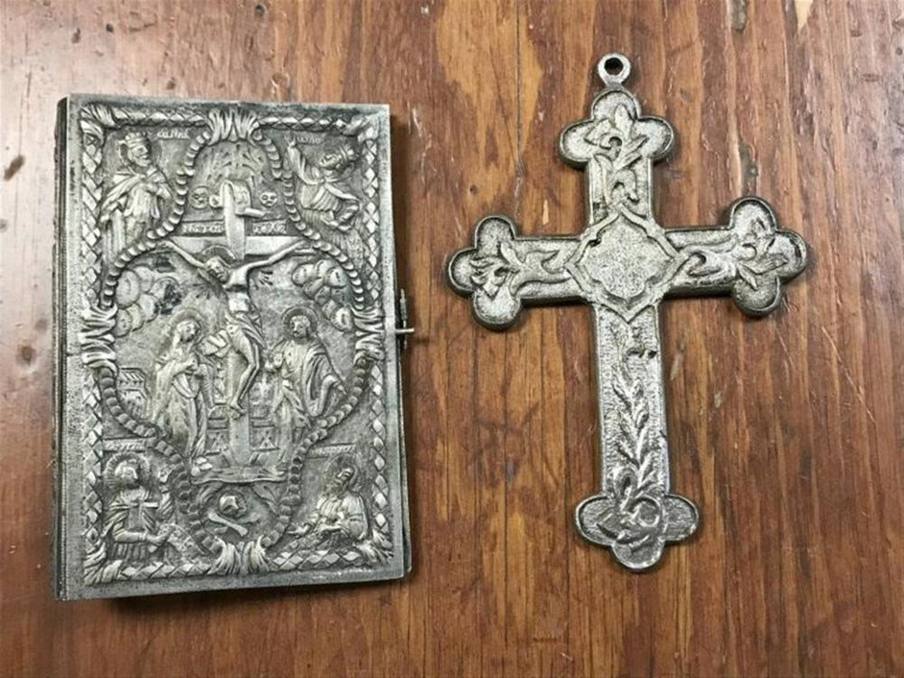 "(2) PCS. PROBABLY EUROPEAN 800 SILVER IS MY GUESS, BOTH NOT MARKED, AND BOTH FROM THE SAFE OF A HUDSON VALLEY MONASTERY. ONE IS A CROSS MEASURING 5"" X 3 1/2"" & OTHER IS A BOOK COVER, WITH SCENES ON BOTH SIDES AND SPINE, MEASURES 4 1/2"" X 3 1/4"".  WEIGT IS 9.83 TROY OUNCES."