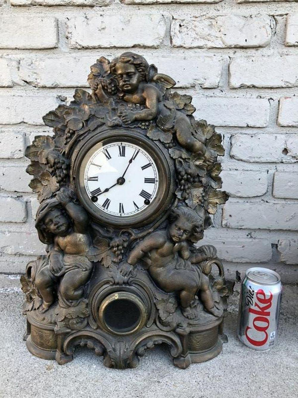 19TH C METAL MANTEL CLOCK WITH 3 CHERUBS AS FOUND
