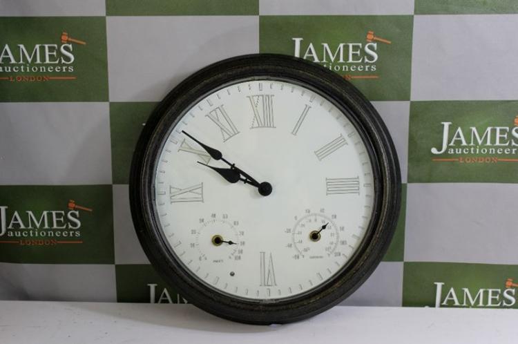 lot 235 a circular wall clock with temperature and humidity dials